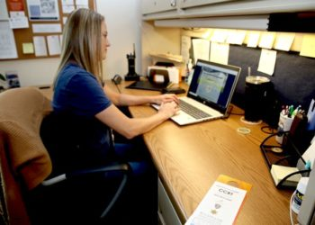 Deputy Tiffany Eisman of Rockford works at her desk in the Crisis Co-Response Team office Wednesday, July 7, 2021, at the Winnebago County Justice Center in Rockford.